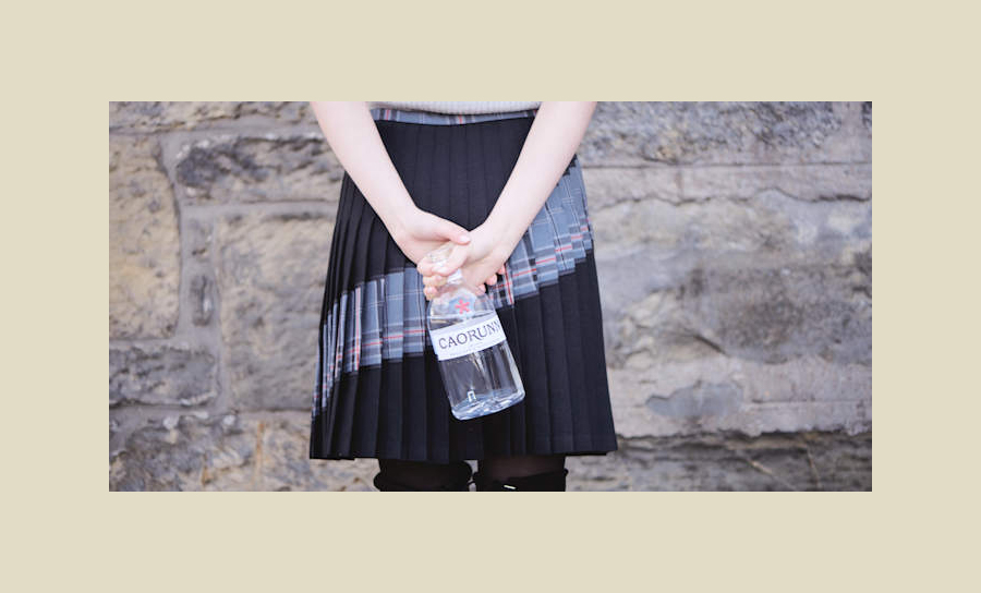 Contemporary Spirit Encapsulated In Bottle And Tartan